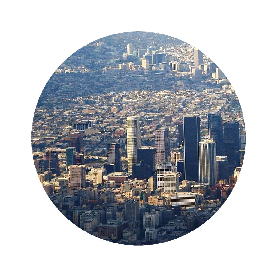 An aerial view of Los Angeles, with tightly packed buildings stretching into the distance.